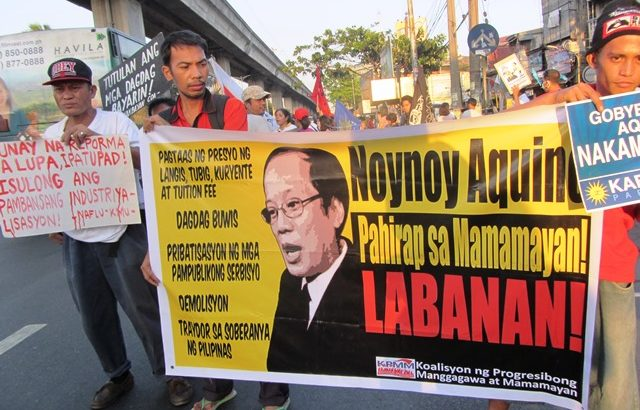 Aquino's new labor laws viewed as 'Trojan horse' vs workers