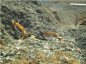 Rescuers are racing against time to find four workers buried alive in a trash avalanche. (Photo by Janess Ann J. Ellao / Bulatlat.com)
