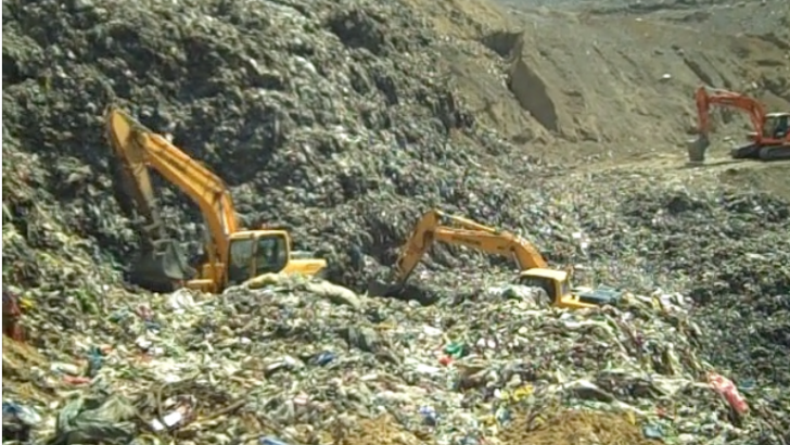 Workers buried in garbage feared dead