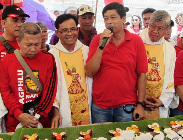 "KMU chairman Elmer ""Bong"" Labog with churchworkers and labor leaders at Plaza Miranda, May 1"