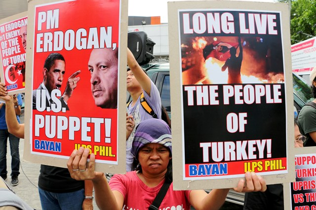 Bagong Alyansang Makabayan in the Philippines hold a picket near the Embassy of Turkey in Dasmariñas Village, Makati City to show support for the people's uprising in Turkey against the regime of Recep Tayip Erdogan. Protesters are outraged at photos showing Turkish protesters and non-protesters being kicked, tear-gassed, shot with  rubber bullets and hit by water canons. (Photo by Jhun Dantes / www.bulatlat.com)