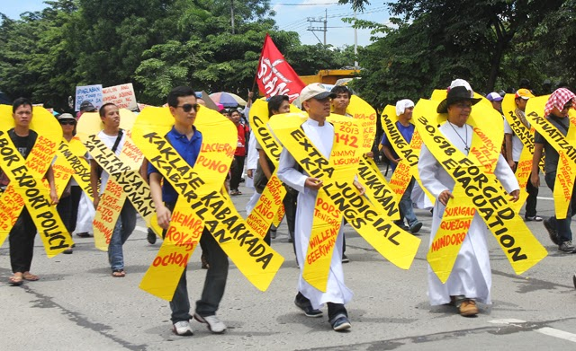 Thousands march to belie 'inclusive growth,' Aquino's State of the Nation Address