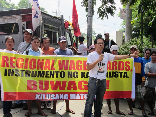 "Joselito Ustarez, vice-chairman of KMU, traces the ""achievements of Regional Wage Boards at blocking significant wage hikes."" (Photo by Marya Salamat / www.bulatlat.com)"