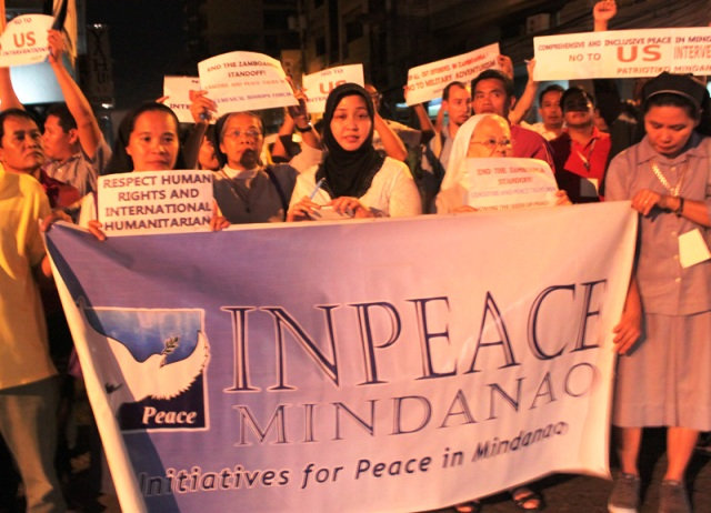 Moro–Christian rally for peace in Zambo gathers in Davao Sulu Princess Jacel Kiram (center) and Catholic nuns. They call for a peaceful resolution to the Zamboanga conflict. The Initiatives for Peace in Mindanao (InPeace) mobilized 100 church leaders and peace advocates in its Mindanao School of Peace in time for the International Day of Peace. (contributed photo, Sept. 20, 2013, davaotoday.com)