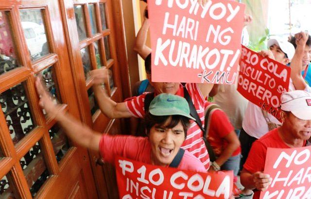 Labor decry 'kaning baboy' wage hike