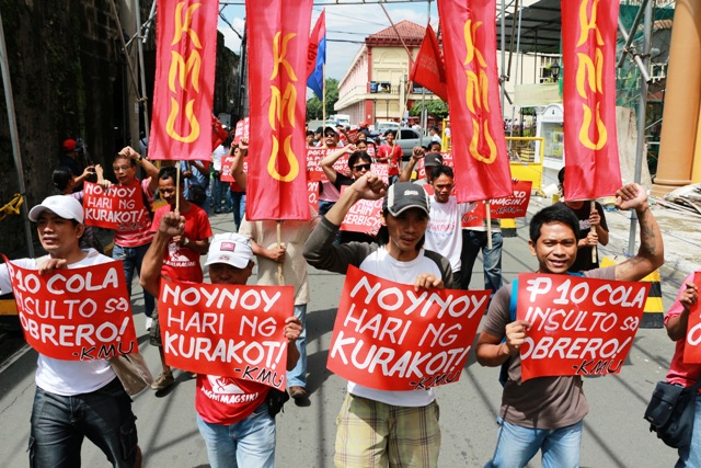 Workers marching to labor department, Sept 10, 2013 (Photo by Jhun Dantes / www.bulatlat.com)