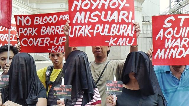 Candles lit against Aquino's war in Zambo