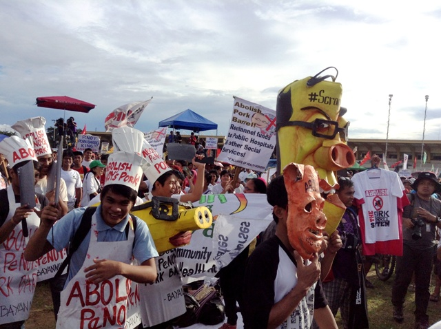 Protesters demand the scrapping of entire pork barrel system, including Noy's biggest pork, to re-channel all discretionary funds directly to services. (Photo by M. Salamat / www.bulatlat.com)