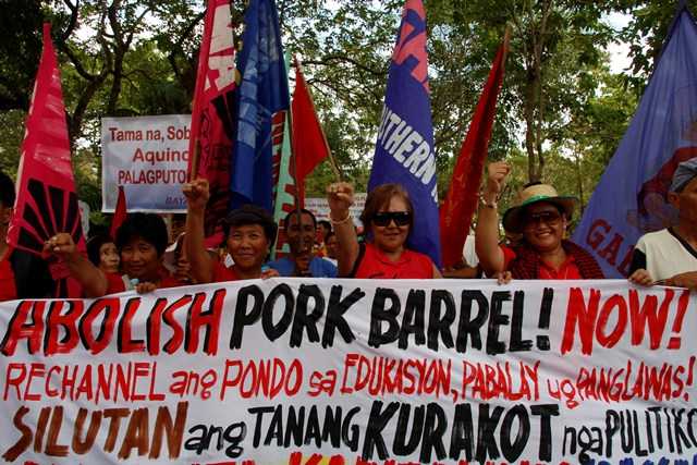 With clenched fists, women protesters slam the pork barrel system.