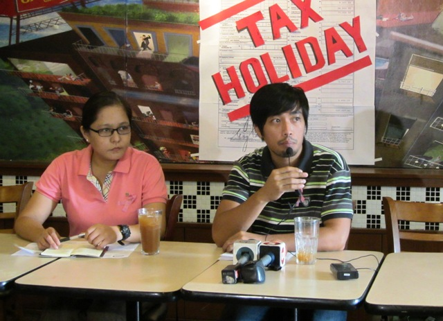 Rakel Rivera of BIEN and Mark Louie Aquino of  Scrap the Pork Alliance ask the BPO employers to support also their tax holiday campaign.