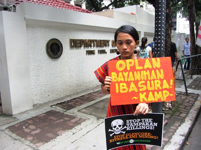 KAMP's Piya Macliing Malayao at the gate of Dept. of Justice shortly before they file an urgent appeal to Justice Sec. de Lima asking for a probe on the prosecutors who dismissed the charges filed by witnesses vs accused soldiers Oct. 18, 2013 (www.bulatlat.com)