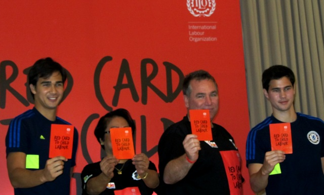 With footballers James and Phil Younghusband, Labor Sec. Rosalinda Baldoz and ILO Director  Lawrence Jeff Johnson raise the red card vs child labor