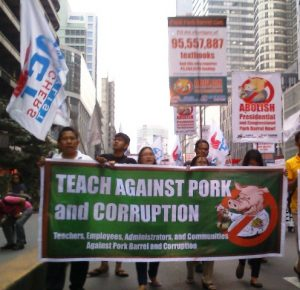 Public school teachers marching towards Paseo Roxas in Makati City for the second Million People March on Friday, Oct. 4. (Photo by Anne Marxze D. Umil/Bulatlat.com)