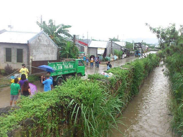 A portion of the relocation area lies next to a river. According to residents, the river overflows at the slightest rain. (Photo by J. Ellao / Bulatlat.com)
