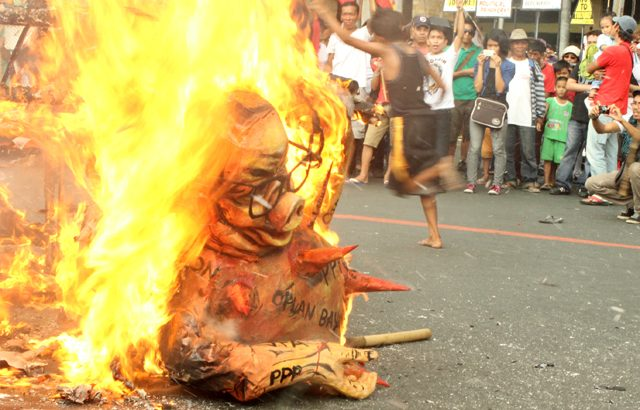 On Int'l Human Rights Day, protesters cite Aquino's sins