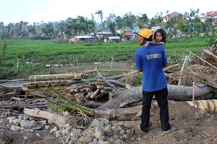 Praeteritum et futurum 2.  An old man seems to ponder what the future holds for his granddaughter in a disaster-hit area.  (Estancia, Iloilo)
