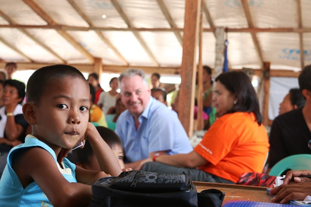 UK Parliamentarian Lord Jack McConnell with Tacloban communities (Photo courtesy of Beyond 2015)