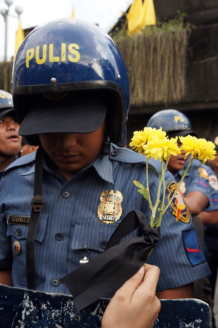 A protester reenacts a popular scene during the EDSA People Power uprising. (Photo by Janess Ann J. Ellao/ Bulatlat.com)