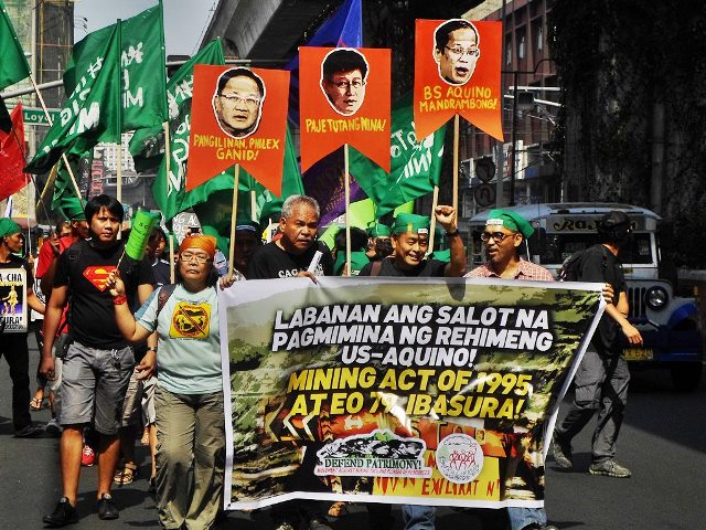 Peasants, workers, members of IP groups, environmentalists, scientists and students march toward Mendiola Bridge to show their anger at the government officials and businessmen behind the sellout of PH resources (Photo by Mon Ramirez, arkibongbayan.org)