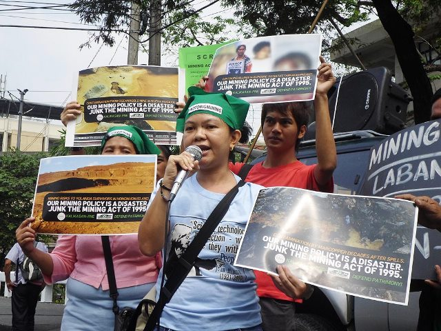 """Finesa Cosico of Agham:  """"History tells us mining liberalization has no beneficial effect, only environmental degradation... Let's not wait till 20th year of Mining Act."""" (Photo by Mon Ramirez)"""