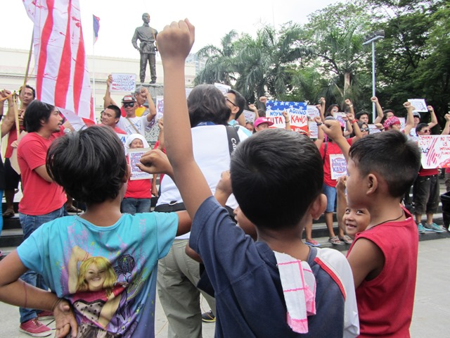 Children playing at Liwasang Bonifacio ask the protesters' permission to join their rally, Apr 25.