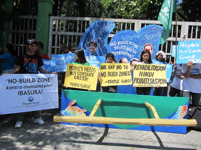 Green groups depict No Build Policy as man-made storm surge against the common people, in Apr 7, 2014 picket at DENR. (Photo by M. Salamat)