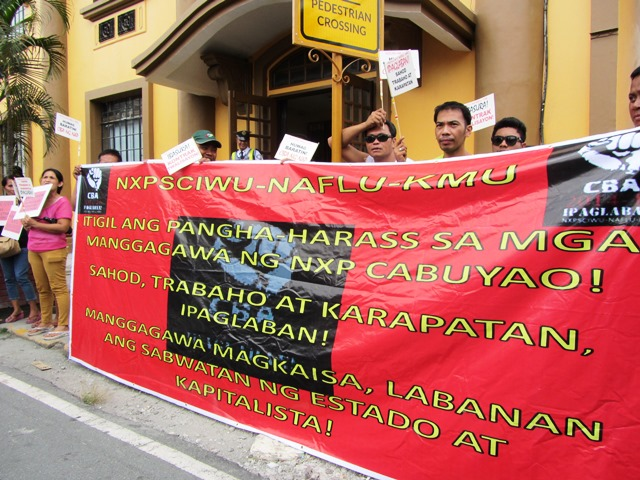 NXP workers picket in front of DOLE as their union negotiators meet with representatives of DOLE and NXP.(Photo by M. Salamat)