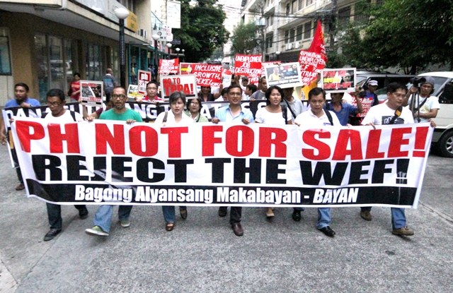 "Coming from a forum ""World Epic Fail: Folly of PPP,"" Progressive groups say 'miracle' in growth happens only to capitalist profit, at the expense of  99.9 percent of population. (Photo by BOY BAGWIS, 23 May 2014 Manila / Bulatlat.com)"