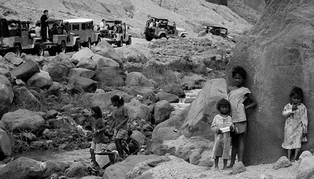 The Aetas are isolated in their own ancestral land by the overwhelming number of tourists swarming Mt. Pinatubo. (Photo by Afol Martin / Bulatlat.com)
