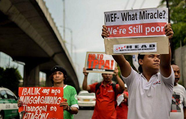 4 arrested in protest vs WEF, Aquino government