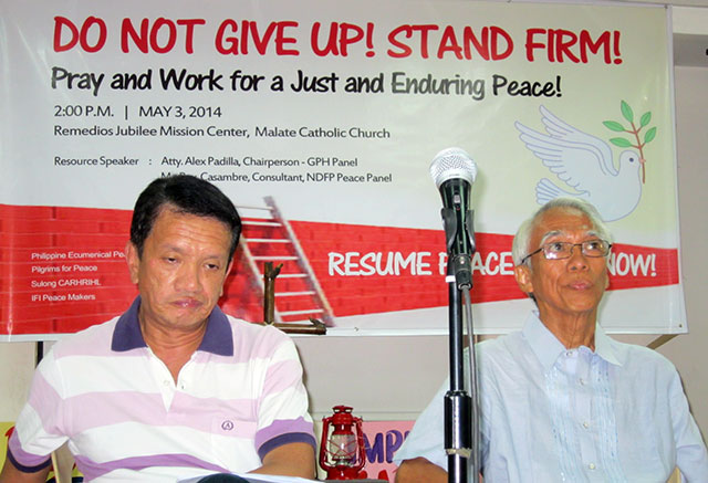 GPH panel chairman Alexander Padilla (left) and Rey Claro Casambre (right) answer questions from members of the Philippine Ecumenical Peace Platform in a forum May 3 in Manila. (Photo by Ronalyn V. Olea/ Bulatlat.com)