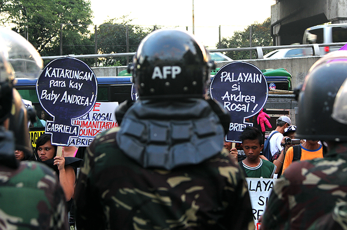 Armed Forces of the Philippines soldiers receive the brunt of condemnation as human rights workers and children's rights advocates demand justice for baby Diona Rosal's death and freedom for her mother Andrea.  (Camp Aguinaldo, Quezon City)
