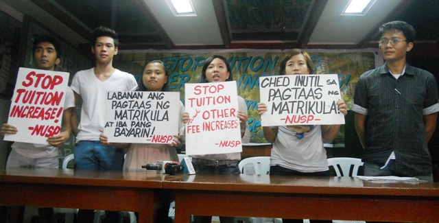 Dianna Delos Santos (second to right) and Shekinah Zafra (second to the left) support the students' struggle against tuition hikes. (Photo by A. Umil/ Bulatlat.com)
