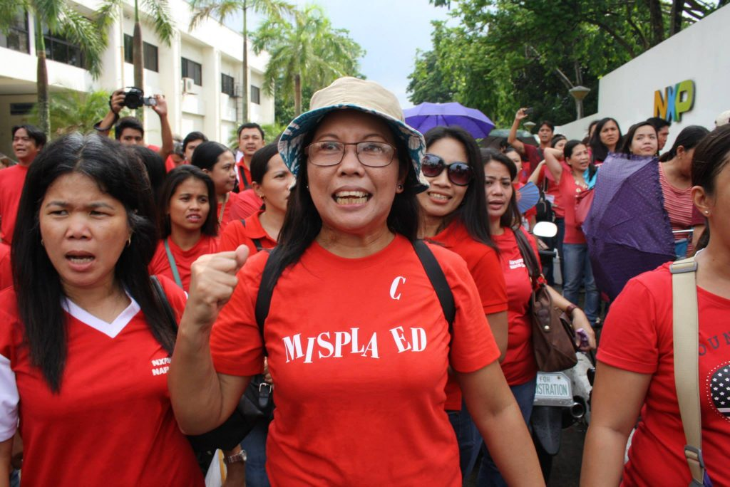 NXP workers join caravan from NXP in industrial economic zone in Laguna to labor dept. headquarters in Manila. They press for completion of CBA talks and reinstatement of 24 union officers. (Bulatlat File Photo, June 2014)