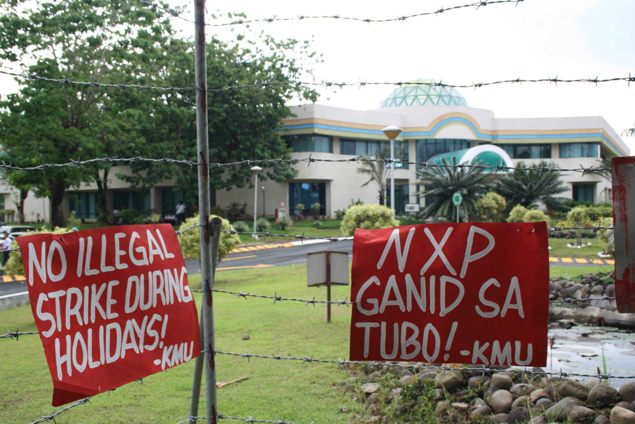 This fence is a new 'development' in NXP at Cabuyao, Laguna. As new as the beefed up security hired by the company to watch over the unionists and prevent their meetings happening at or near the workplace. The union is pressing NXP for a 7-percent wage hike. (Photo courtesy of KMU Public Info Dept.)