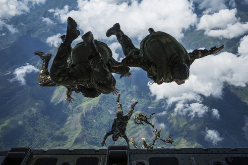 "Scene from Balikatan 2014 live fire training: Philippine Army Special Forces do freefall jump from a US ""Sumos"" assault support aircraft, over Crow Valley, home of Aetas. (U.S. Marine Corps photo by Lance Cpl. Allison DeVries/Released)"