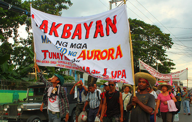 "Farmers from Aurora province join the five-day protest action dubbed as ""March of CARP Victims for Genuine Agrarian Reform."" CARP or the Comprehensive Agrarian Reform Program is the government's agrarian reform program. (Photo by Ronalyn V. Olea / Bulatlat.com)"