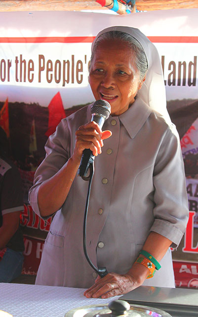 Benedictine nun Sister Miriam Noemi Francisco vows to continue supporting Hacienda Looc farmers during the launch of the Defend Hacienda Looc Alliance, June 4 in Calayo village, Nasugbu, Batangas. (Photo by Ronalyn V. Olea)