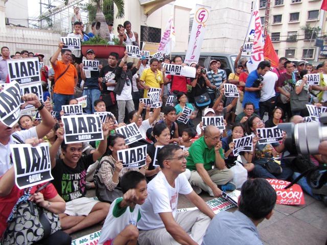 Members of progressive organizations strike down Aquino's DAP defense as lies, in a protest action at Plaza Miranda (Photo by M. Salamat / Bulatlat.com)