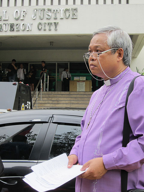 Bishop Reuel Norman Marigza, general secretary of the United Church of Christ in the Philippines (UCCP), demands justice for the slain UCCP members, Aug. 22. (Photo by Ronalyn V. Olea / Bulatlat.com)