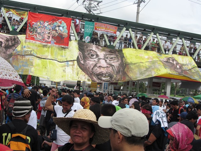 Murals depicting Noynoy Aquino share space at a footbridge near Ever Commonwealth