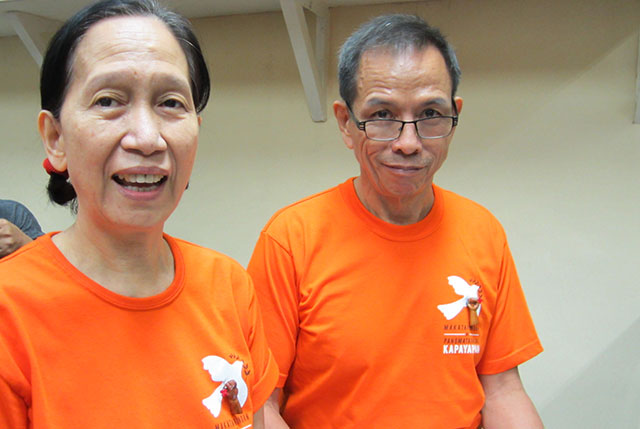 Wilma Austria and Benito Tiamzon, consultants of the National Democratic Front of the Philippines in its peace negotiations with the government, attend the pre-trial hearing at the Quezon City Regional Trial Court, Aug. 11. (Photo by Ronalyn V. Olea/ Bulatlat.com)