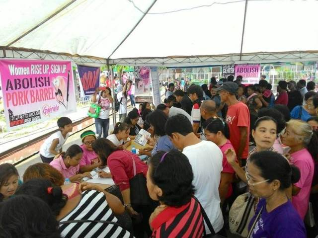 Signatories line up to sign  up vs pork (Photo from Davao Today)