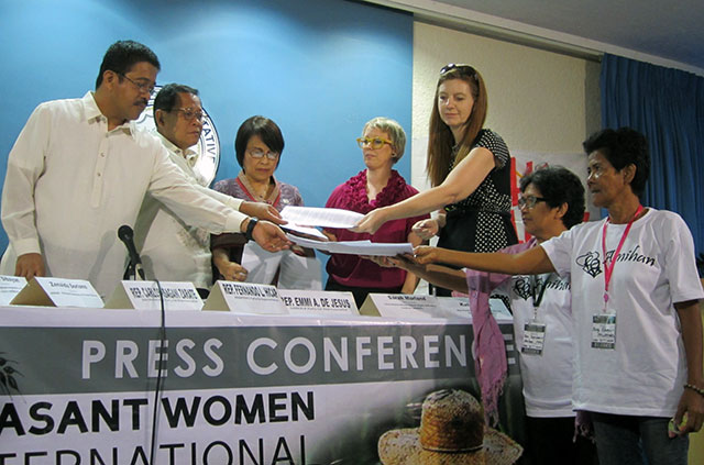 Members of the solidarity mission provide a copy of their initial findings to representatives of the Makabayan bloc. (Photo by Ronalyn V. Olea/ Bulatlat.com)