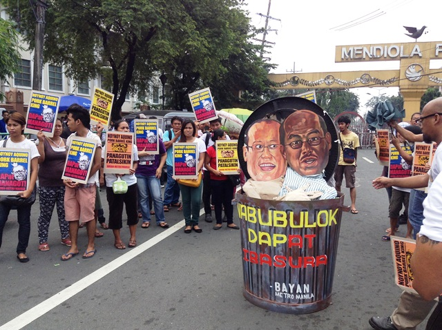 Protesters propose to 'dispose' of the tandem of President Aquino and Budget Sec. Abad, creators, implementors and defenders of unconstitutional DAP,  in a rally at Mendiola Oct 7. (Photo by M. Salamat / Bulatlat.com)