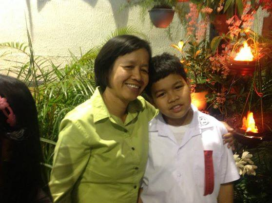 Fidela Salvador with son. (Photo from the Facebook account Quest for Justice for Engr. Delle Salvador/ Bulatlat.com)