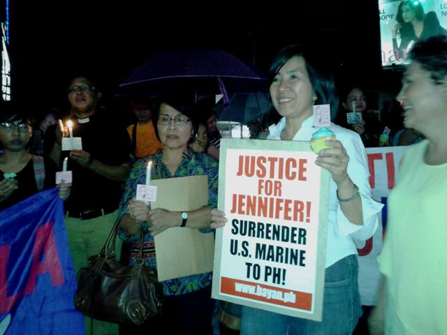 """The """"Justice for Jennifer Laude, Junk VFA Network"""" lit candles in Quezon City on Oct 17.  (Photo by A.E. dela Cruz)"""