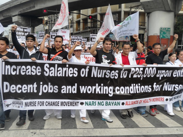 Nurses marching towards Chino Roces Bridge (former Mendiola Bridge), Friday, Oct. 17. (Photo by A. Umil/ Bulatlat.com)