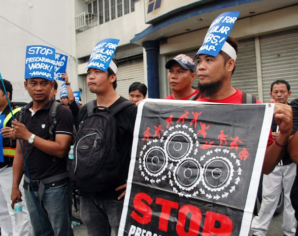 Members of Metal Workers Alliance of the Philippines mark World Day for Decent Work with a motorcade and picket in Laguna.