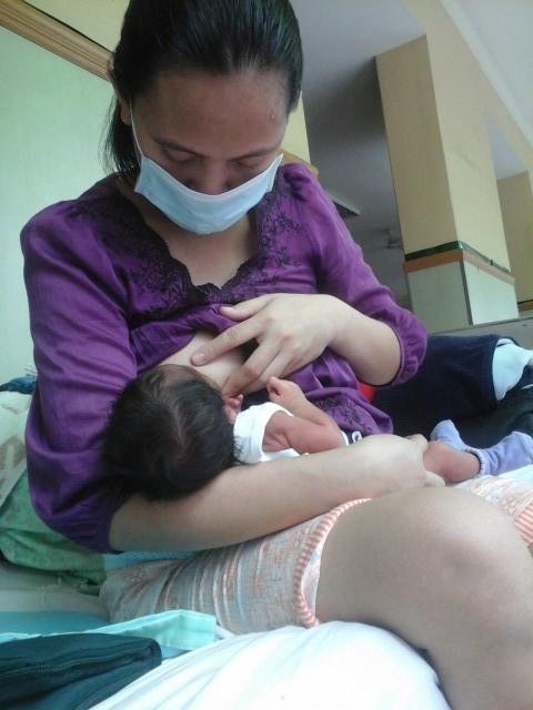 Miradel Torres nursing her son